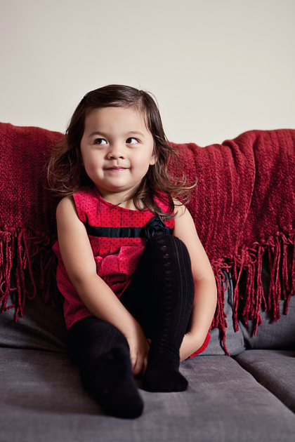 Rowan is only a child, but she can look so devious! She smiles and looks at something out of the corner of her eye.