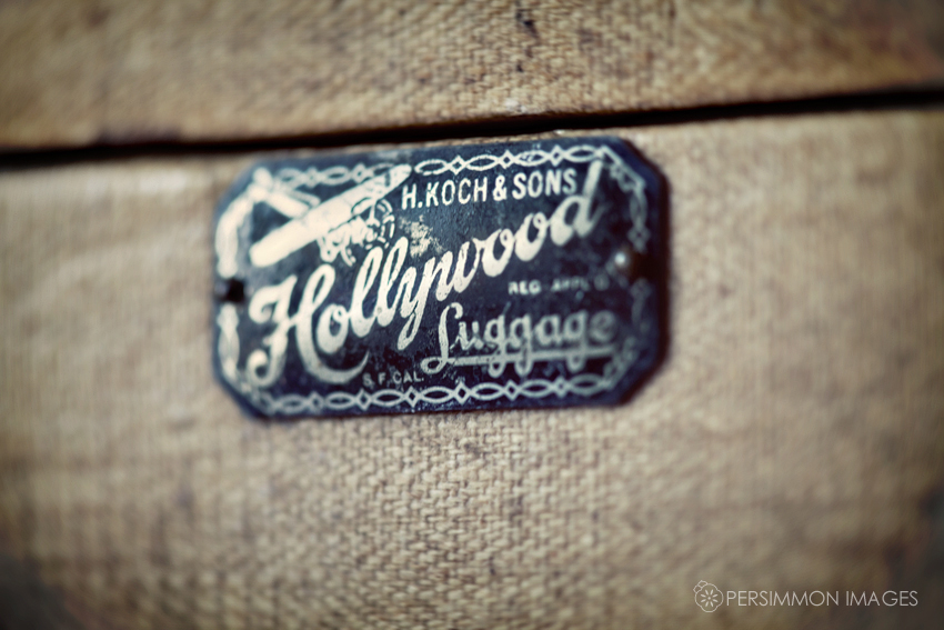 Hollywood luggage logo tag on vintage suitcase