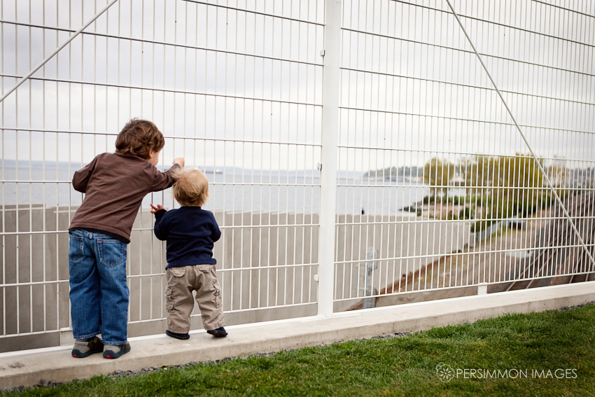 Caleb and Liam watch for freight trains together along Seattle