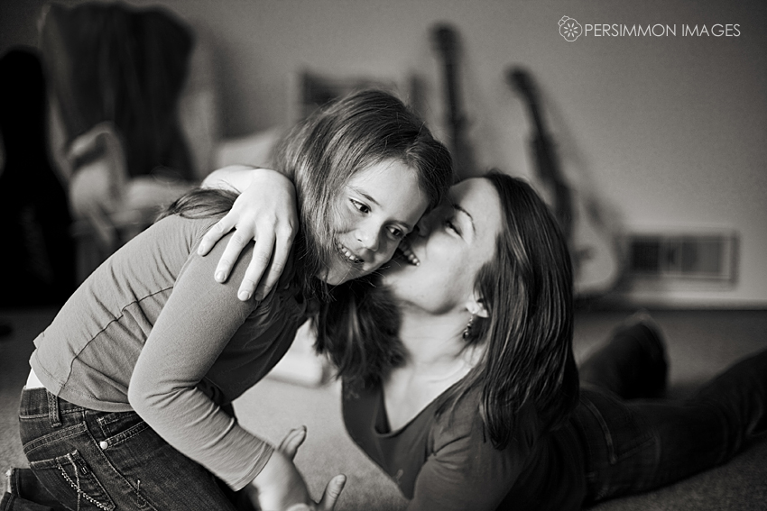 Therese hugs Rose in their living room before their portrait session