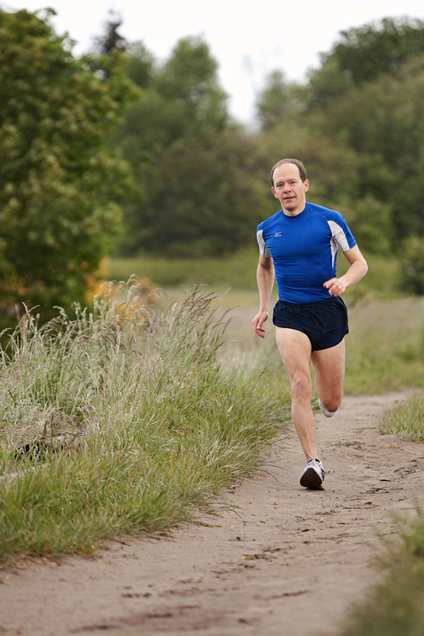 Michigan resident Anthony Targan running in Discovery Park while photographed by Persimmon Images