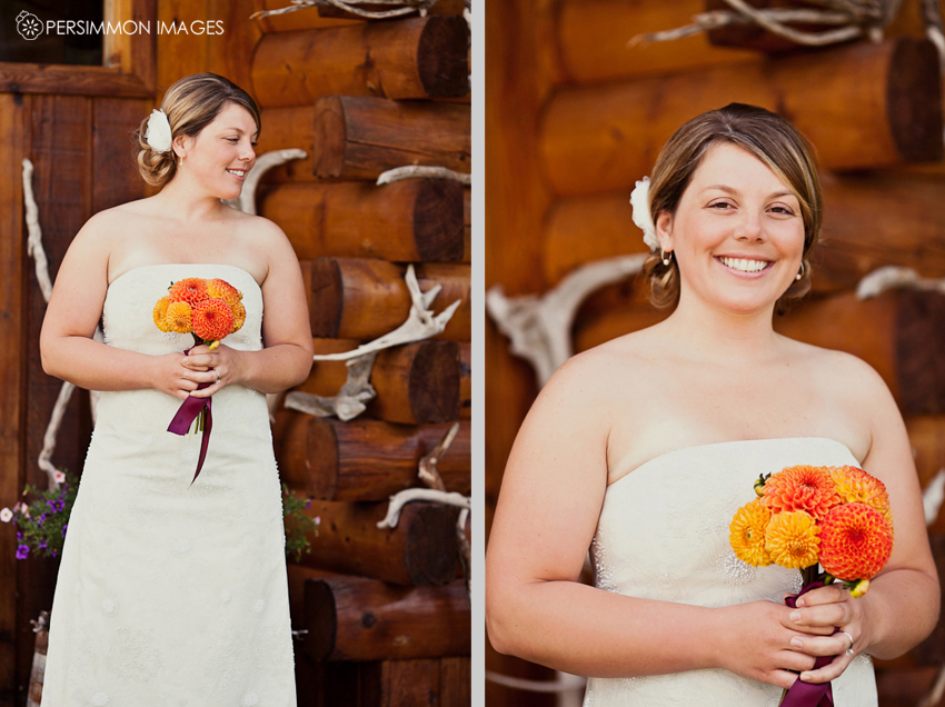 Montana bride posing near antlers on a log cabin