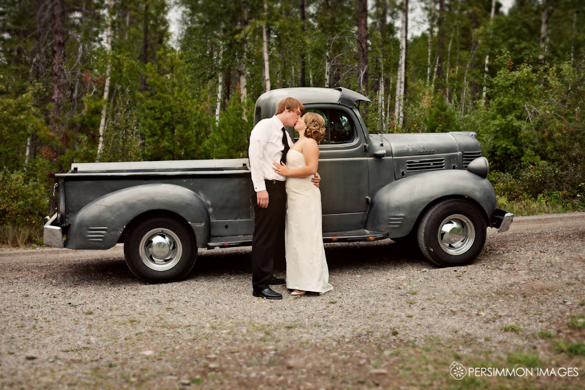 Bride and groom photographed with an old truck. Contemporary wedding photography by Persimmon Images.