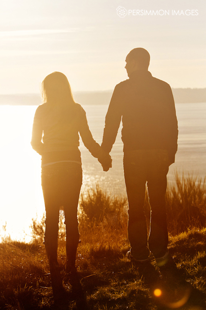 couple holding hands in sunset. of couple holding hands