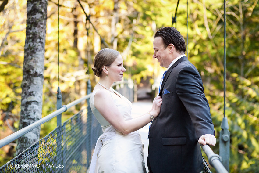 Bainbridge wedding photography at Islandwood, a school in the woods. Bride and groom on the Islandwood suspension bridge. By Persimmon Images wedding photographers.