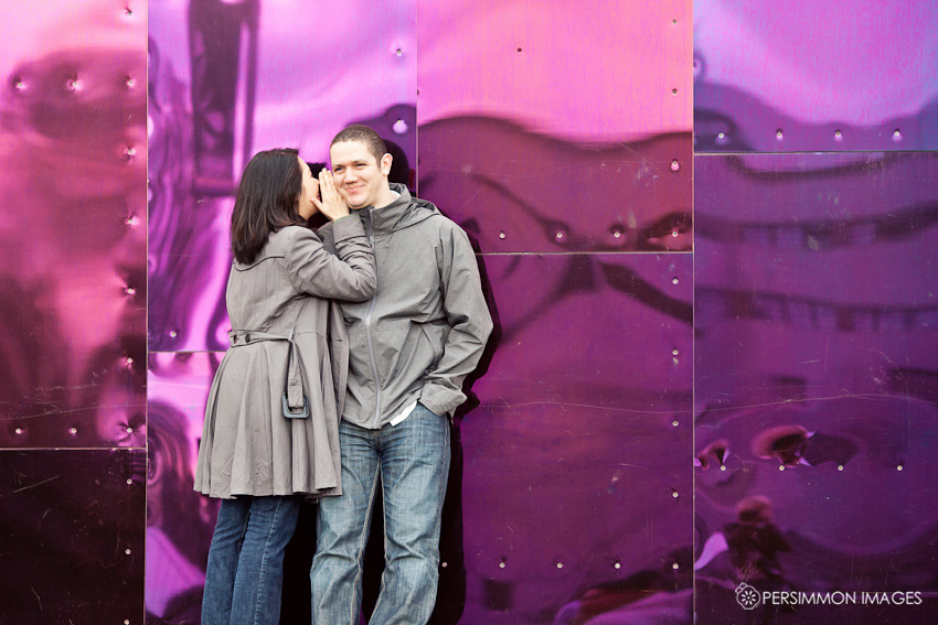 EMP and Science Fiction Museum engagement photography with couple in front of purple wall