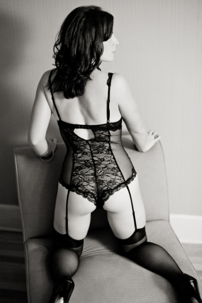 Seattle boudoir photographers at Persimmon Images photograph bride in black lingerie, stockings, and garters in sexy glamour poses.