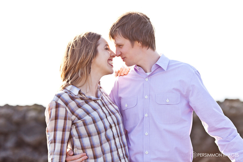 Modern engagement photograph of young couple nose to nose at Seattle