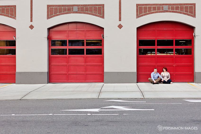 Belltown Fire Station engagement photographs in Seattle, WA with red fire station doors