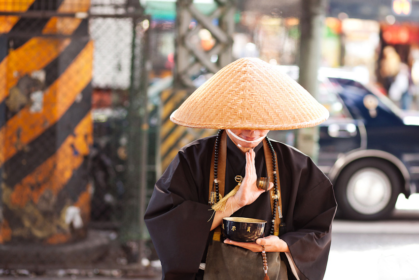 A Buddhist Monk asking for alms outside Ueno station