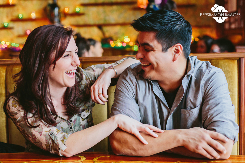 Modern, candid engagement photography for Seattle couples at Toulouse Petit restaurant on Queen Anne