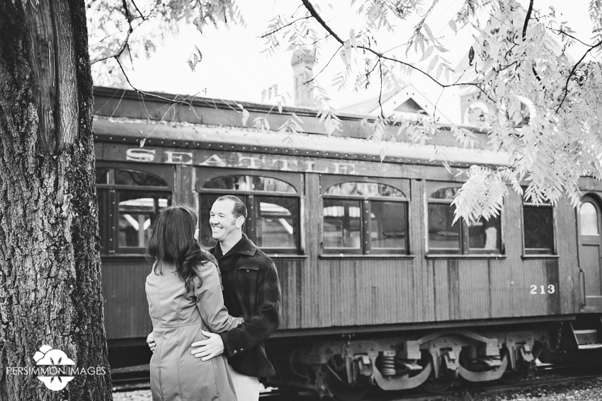 Rainy day fall foliage and colors engagement photographs at Snoqualmie train museum with vintage rail cars