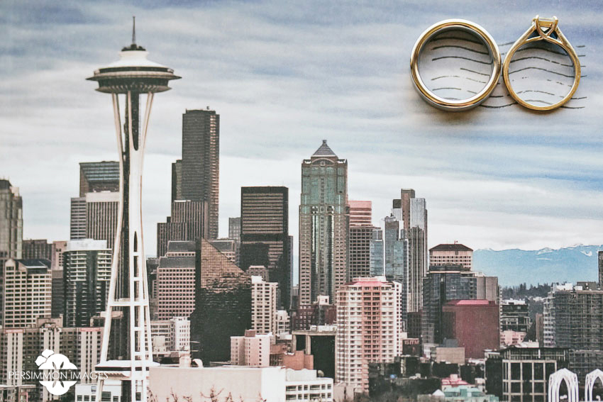 Seattle wedding photography of Seattle postcard with wedding rings at Olive 8 Hyatt hotel downtown